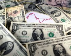 Dollar holds gains as investors cheer U.S. economic outlook By Reuters