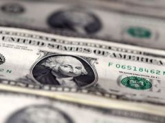 Dollar slips as hopes for virus treatment prop up risk appetite By Reuters