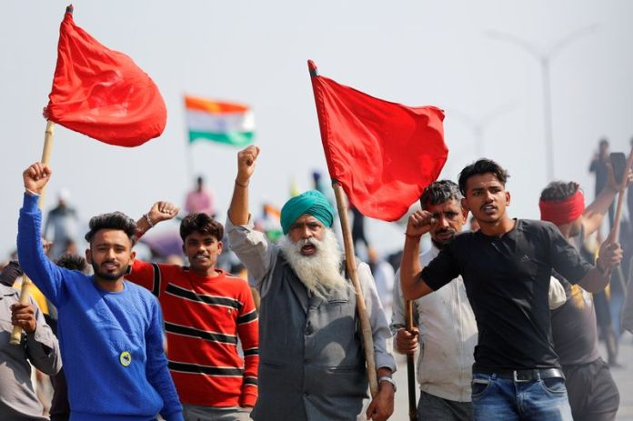Indian farmers block highway outside Delhi to mark 100th day of protest