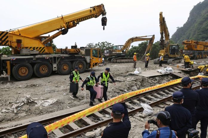 Taiwan minister accepts responsibility for train crash as questions mount