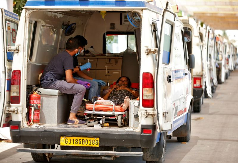 India infections top 18 million as gravediggers work round the clock