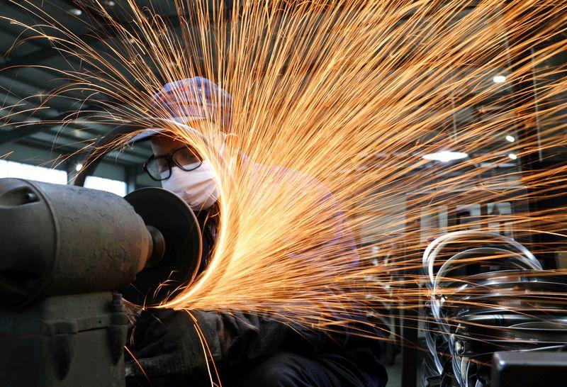 China's factory activity growth slows on supply bottlenecks, soft demand