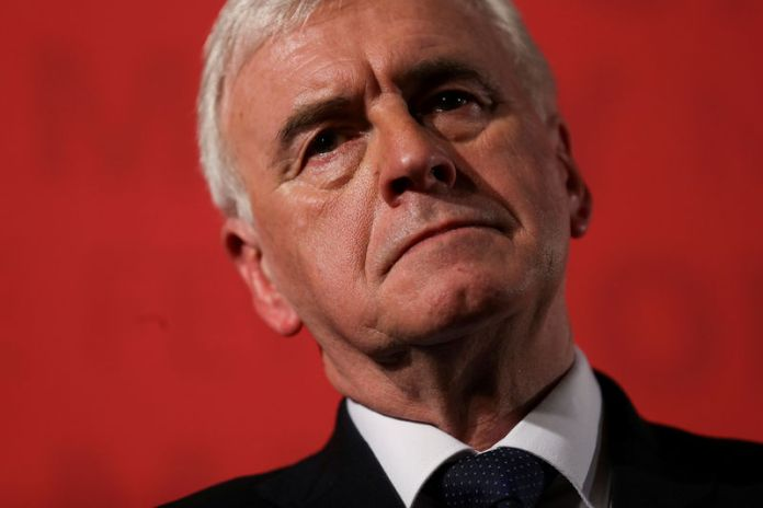 © Reuters. FILE PHOTO: Britain's Shadow Finance Minister John McDonnell, pauses as he sets out Labour's demands for the Spring Statement, in London