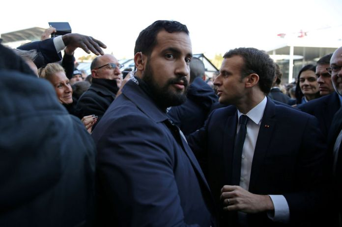 © Reuters. FILE PHOTO: Elysee senior security officer Alexandre Benalla stands next to French President Emmanuel Macron during a visit to the Paris International Agricultural Show in Paris