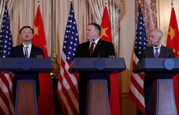 © Reuters. U.S. Secretary of State Mike Pompeo and Defense Secretary James Mattis listen to Chinese Communist Party Office of Foreign Affairs Director Yang Jiechi speak during a joint media news conference in Washington