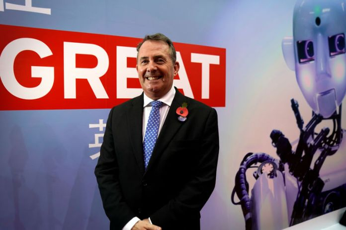 © Reuters. Britain's International Trade Secretary Liam Fox is interviewed by Reuters at the China International Import Expo (CIIE), at the National Exhibition and Convention Center in Shanghai