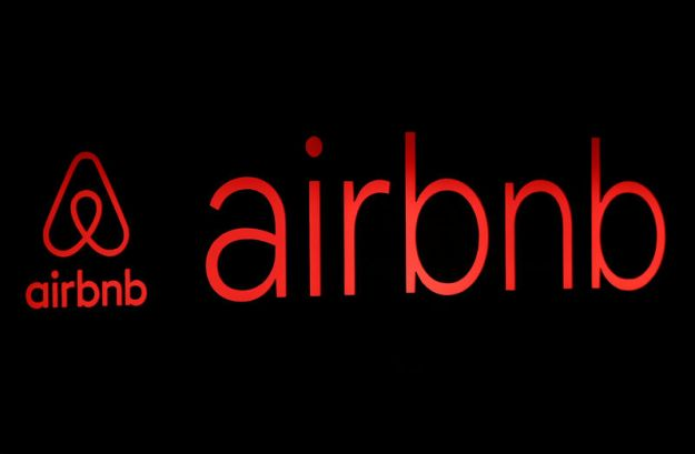 © Reuters. The logos of Airbnb are displayed at an Airbnb event in Tokyo