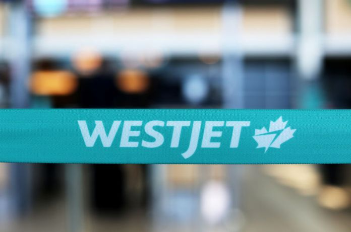 © Reuters. WestJet airline signage is pictured at Vancouver's international airport in Richmond,