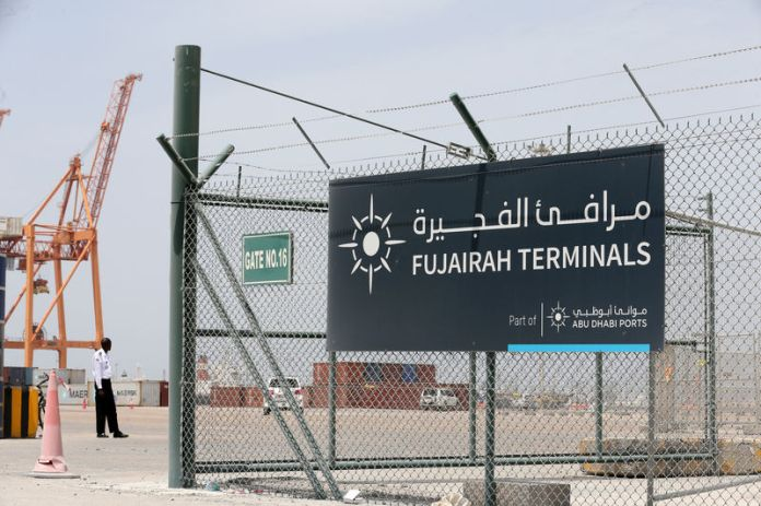 © Reuters. FILE PHOTO: A sign of Fujarah Terminals is pictured at the Port of Fujairah