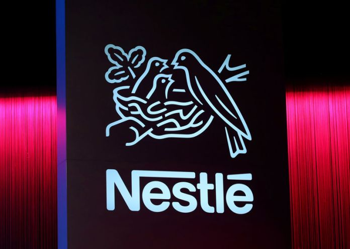 © Reuters. FILE PHOTO: Logo is pictured during the 152nd Annual General Meeting of Nestle in Lausanne