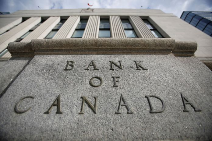 © -. FILE PHOTO: A sign is pictured outside the Bank of Canada building in Ottawa