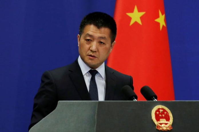 © -. Chinese Foreign Ministry spokesman Lu Kang answers questions about a major bus accident in North Korea, during a news conference in Beijing