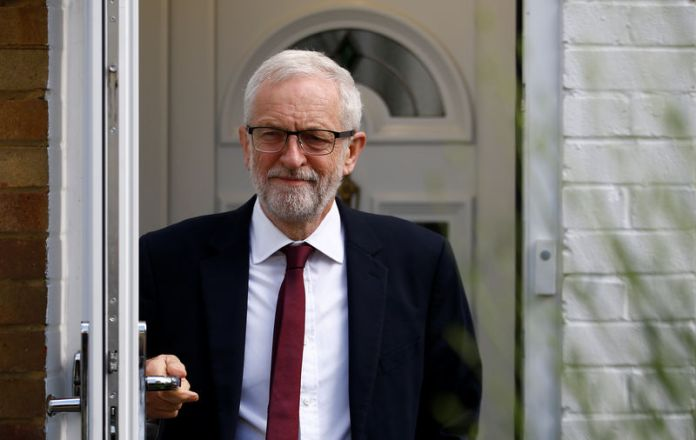 © -. Britain's opposition Labour Party leader Jeremy Corbyn leaves his home in London