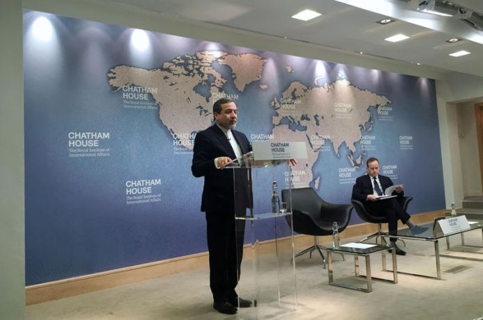 © -. Iran's Deputy Foreign Minister Abbas Araqchi speaking at the Chatham House think tank in London