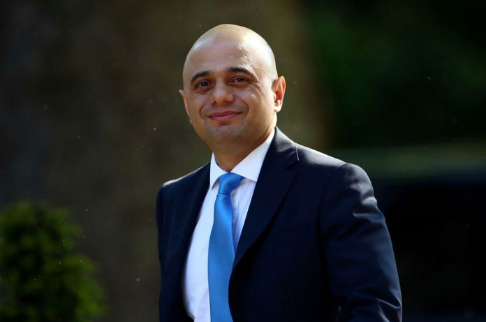 © -. FILE PHOTO: Britain's Home Secretary Sajid Javid is seen outside Downing Street, as uncertainty over Brexit continues, in London