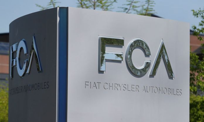 © -. FILE PHOTO: A Fiat Chrysler Automobiles sign is seen at the U.S. headquarters in Auburn Hills, Michigan,