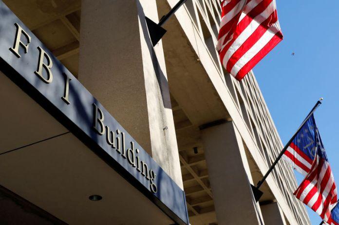 © -. FILE PHOTO: FBI headquarters building in Washington