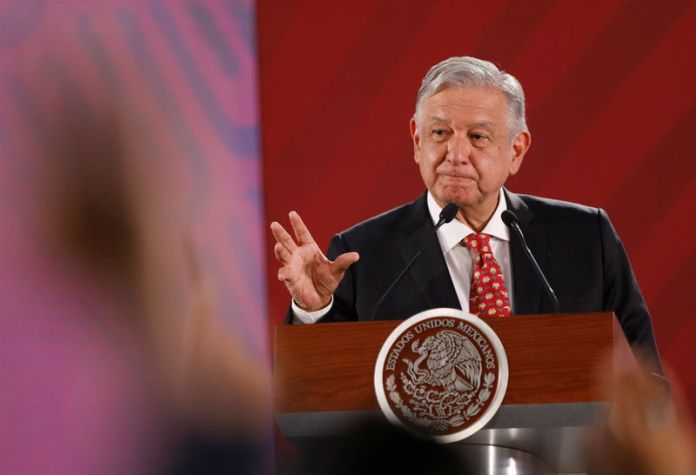 © -. FILE PHOTO: Mexico's President Andres Manuel Lopez Obrador gestures during a news conference at the National Palace in Mexico City