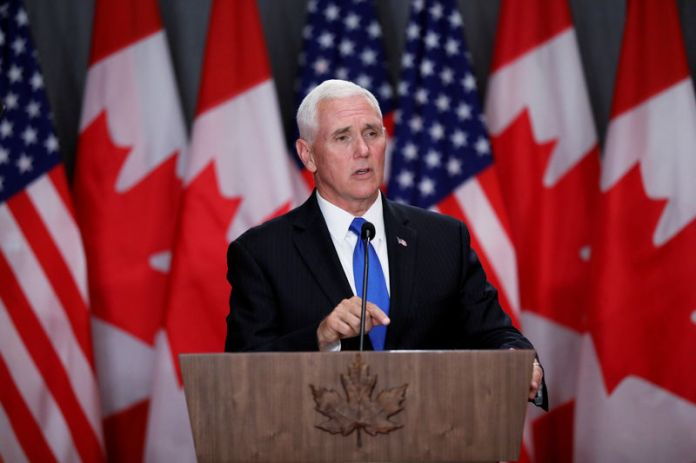 © -. U.S. Vice President Mike Pence speaks during a news conference in Ottawa