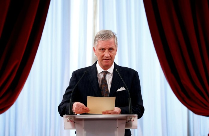 © -. FILE PHOTO: Belgium's King Philippe delivers a speech during a traditional new year's reception at the Royal Palace in Brussels