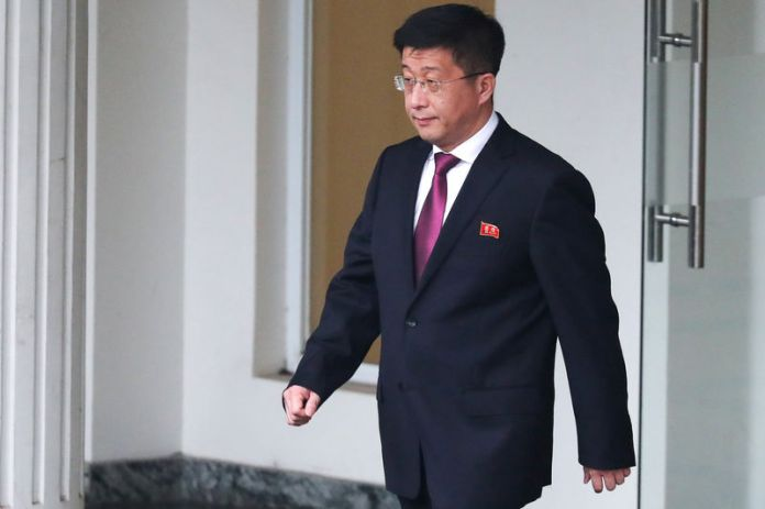 © -. Kim Hyok Chol, North Korea's special representative for U.S. affairs, leaves the Government Guesthouse in Hanoi