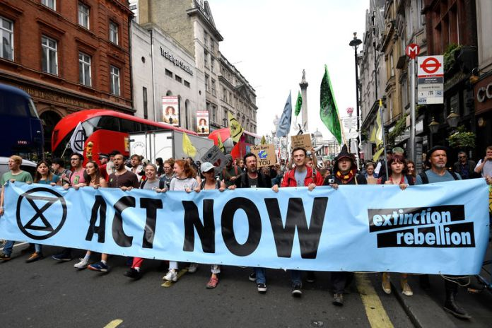 © -. FILE PHOTO: Demonstrators march along Whitehall during an Extinction Rebellion protest in London
