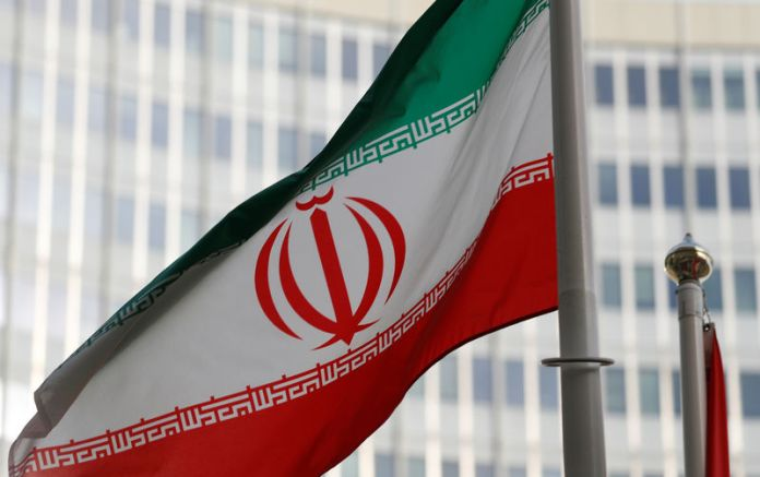 © -. The Iranian flag flutters in front the International Atomic Energy Agency (IAEA) headquarters in Vienna