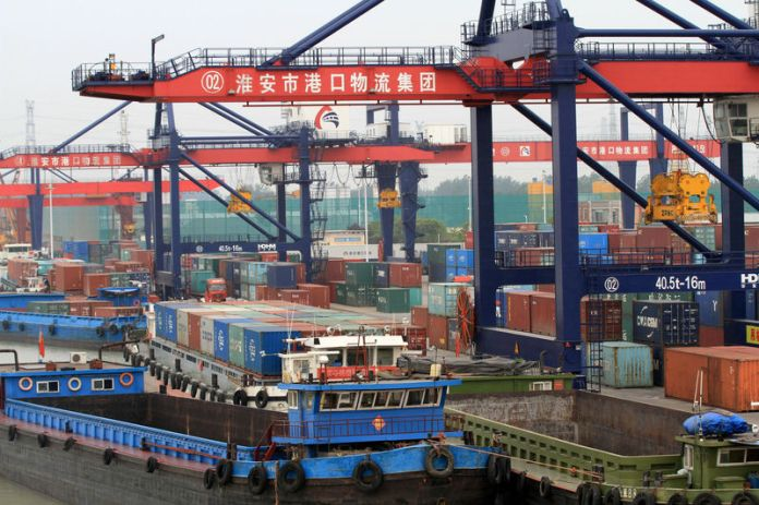 © -. Containers are seen at a port in Huaian
