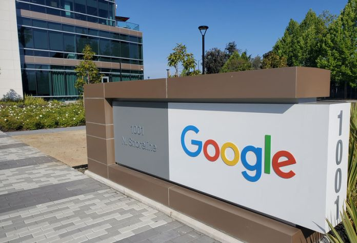 © -. FILE PHOTO: A sign is pictured outside a Google office near the company's headquarters in Mountain View, California