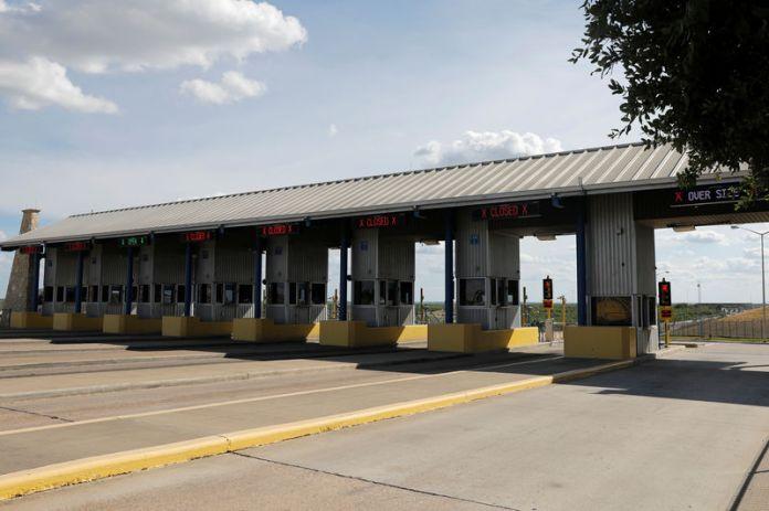 © -. Border gates are seen at the World Trade Bridge border with Mexico, in Laredo, Texas