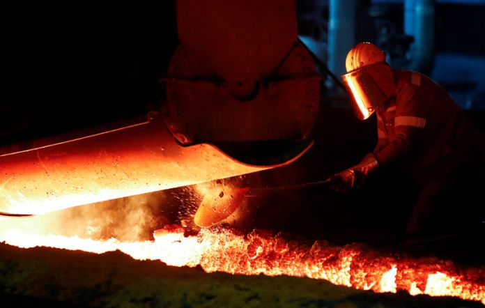 © -. FILE PHOTO: A steel worker of Germany's industrial conglomerate ThyssenKrupp AG works near a blast furnace at Germany's largest steel factory in Duisburg
