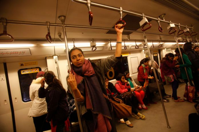 © -. Simrat, 24, who works for a non-profit arts organisation, travels in the women's compartment of a metro in New Delhi
