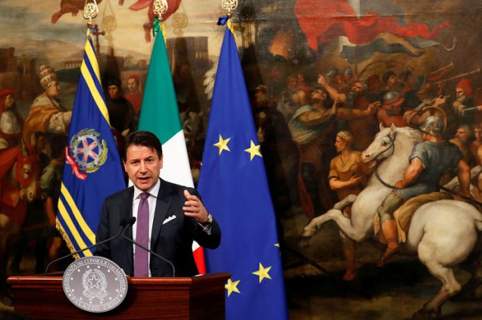 © -. Italian Prime Minister Giuseppe Conte gestures as he holds a news conference at Chigi Palace in Rome