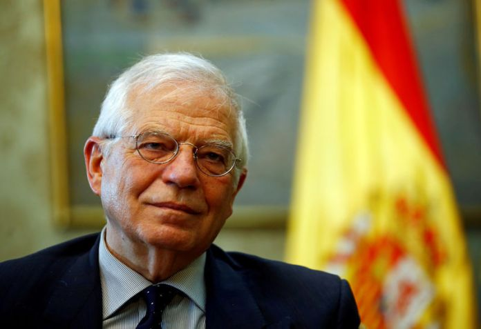 © -. FILE PHOTO: Spain's Foreign Minister Josep Borrell talks during an interview commenting on the possible Brexit extension, in Madrid