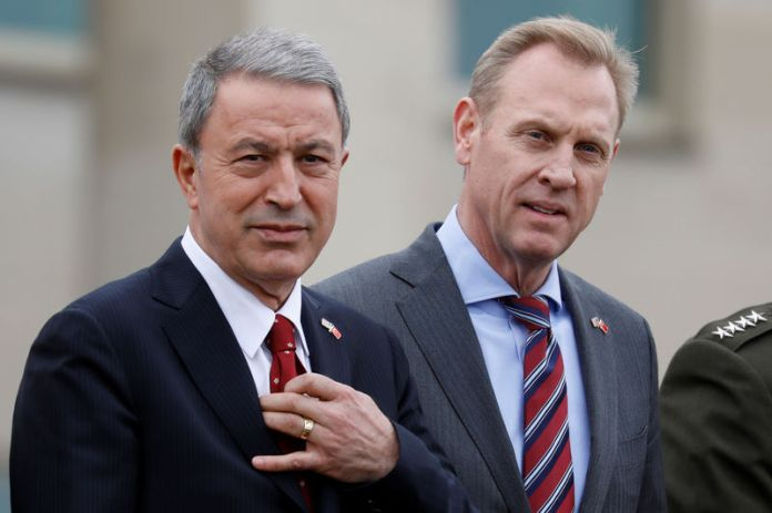 © -. Acting Defense Secretary Patrick Shanahan welcomes Turkish Minister of Defense Hulusi Akar