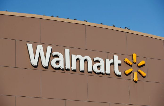 © -. FILE PHOTO: Walmart's logo is seen outside one of the stores in Chicago
