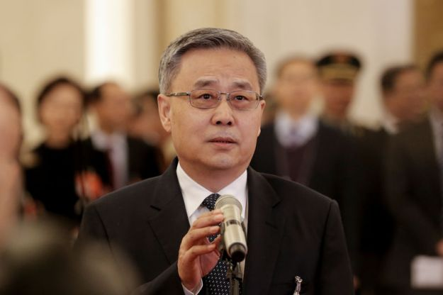 © Reuters. China's top banking regulator Guo Shuqing speaks to reporters on the sidelines of the National People's Congress (NPC) at the Great Hall of the People in Beijing