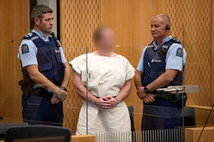 © -. FILE PHOTO: Brenton Tarrant, charged for murder in relation to the mosque attacks, is seen in the dock during his appearance in the Christchurch District Court