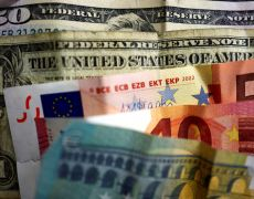 Dollar hobbled by lower U.S. yields, pound sags on dovish BoE By Reuters