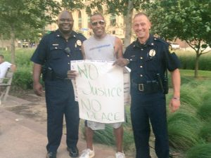Dallas police and protestor
