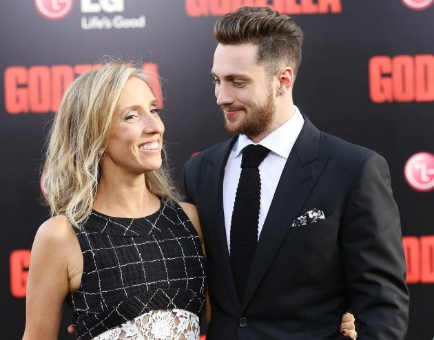 Sam Taylor-Wood and Aaron Taylor-Johnson at the premiere of 'Godzilla' on May 8, 2014 in Hollywood