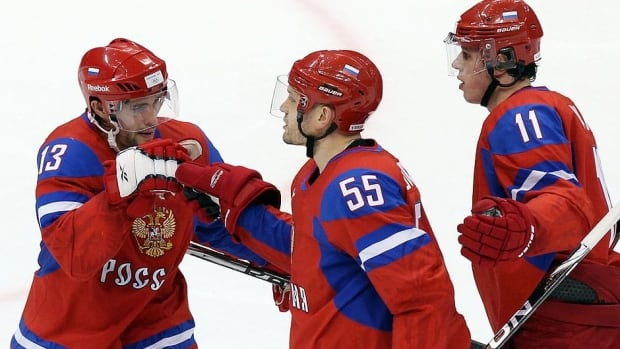 From left, Russian forwards Pavel Datsyuk, Sergei Gonchar and Evgeni Malkin, seen here at the 2010 Vancouver Olympics, are expected to attend the team's Aug. 23-24 camp in Sochi, Russia, site of the 2014 Winter Games.