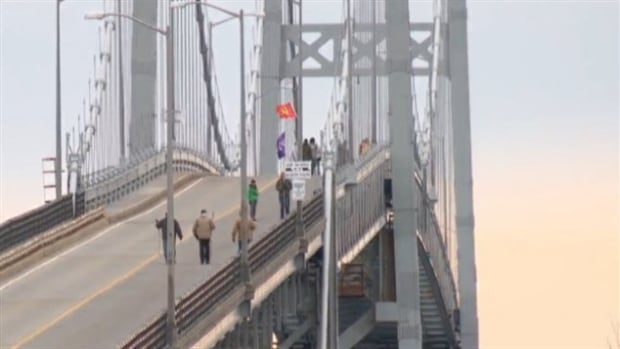 A small group of anti-fracking protesters marched across the Seaway International Bridge Saturday afternoon.