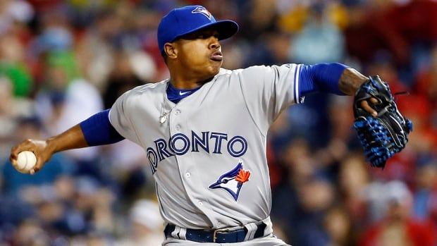 The Blue Jays' Marcus Stroman pitches during the ninth inning of an interleague game against the Phillies in Philadelphia on Tuesday night. He tossed 1 1/3 innings of relief, striking out one to earn his first major league win.