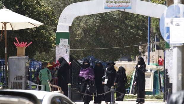 The Islamic State in Iraq and Syria has imposed Shariah law in parts of Syria and Iraq. Here, veiled women walk along a street in the northern province of Raqqa, Syria.