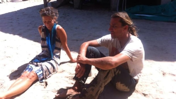 Andy Wasinger and Loretta Reinholdt relax on the beach at Jeanette Kawas National Park shortly after being rescued from the jungle following an attack by pirates in Honduras.