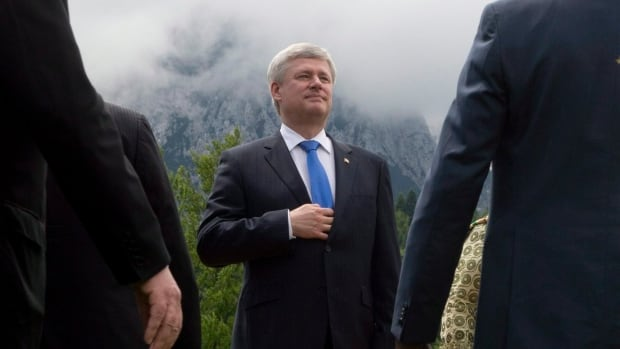Canadian Prime Minister Stephen Harper takes his place for the official family photo with outreach partners at the G7 Summit in Garmisch, Germany, on Monday.