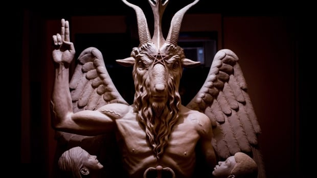 "The Satanic Temple unveiled the one-ton statue at an industrial building near the Detroit River just before 11:30 p.m. local time as supporters cheered, ""Hail Satan."""