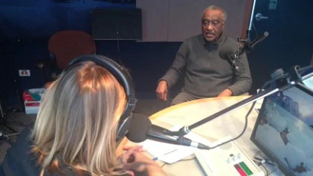 Addisu Kello speaks with CBC Information Radio host Marcy Markusa in studio.