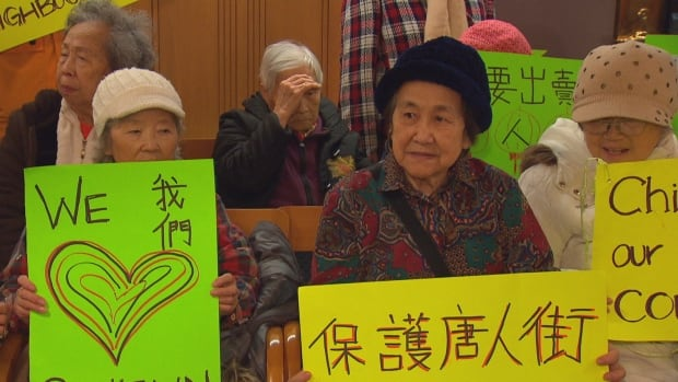 Protesters were at city hall on Monday to protest a new mixed-use tower being proposed in Chinatown.